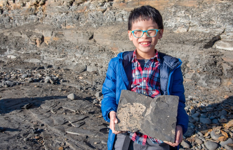 child holding a fossil